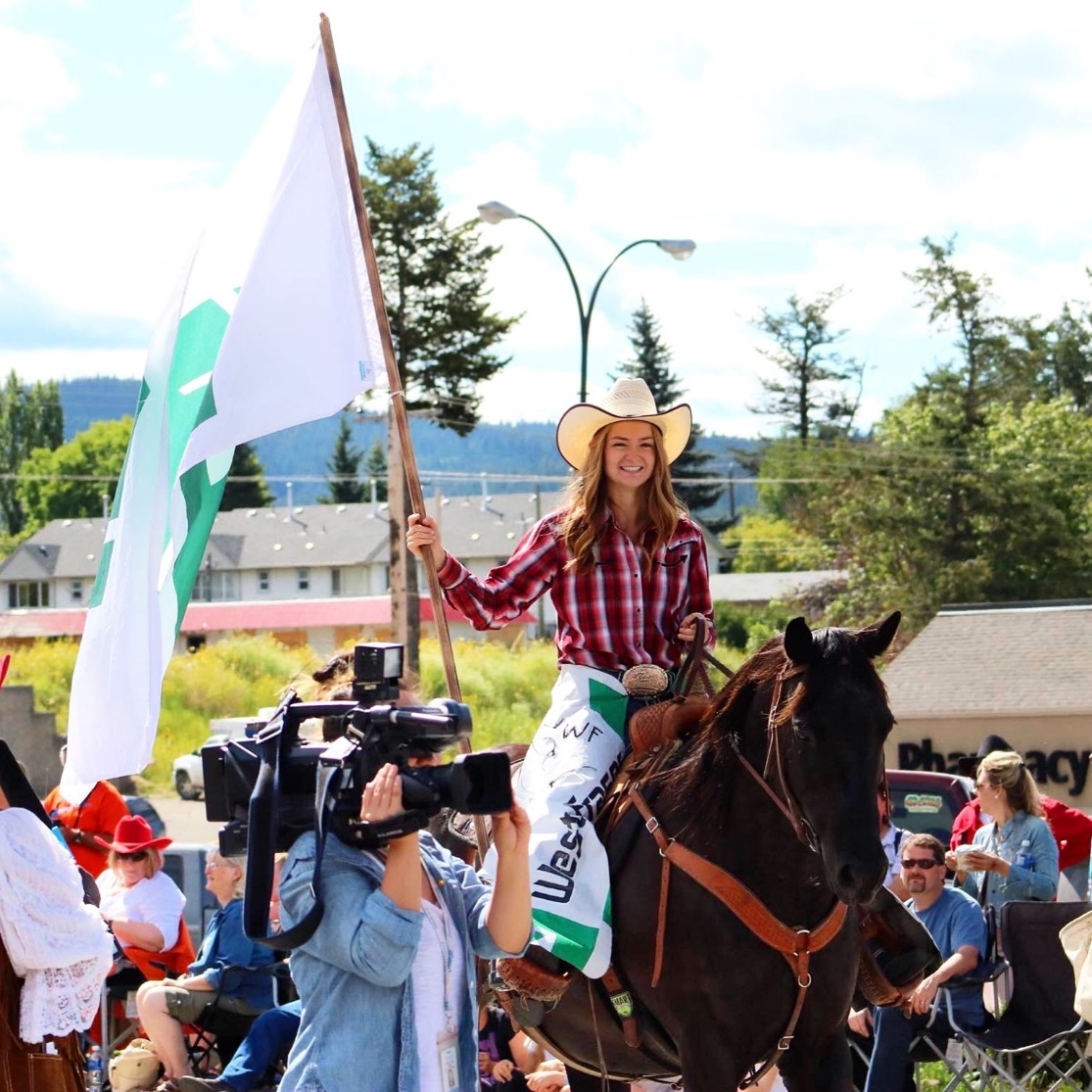 Credit: Shelley Porter (for more awesome stampede images, check her out on Facebook!) Nahoni and I proudly showing off the West Fraser Flag during the parade. As you can tell, I was incredibly happy to be there!