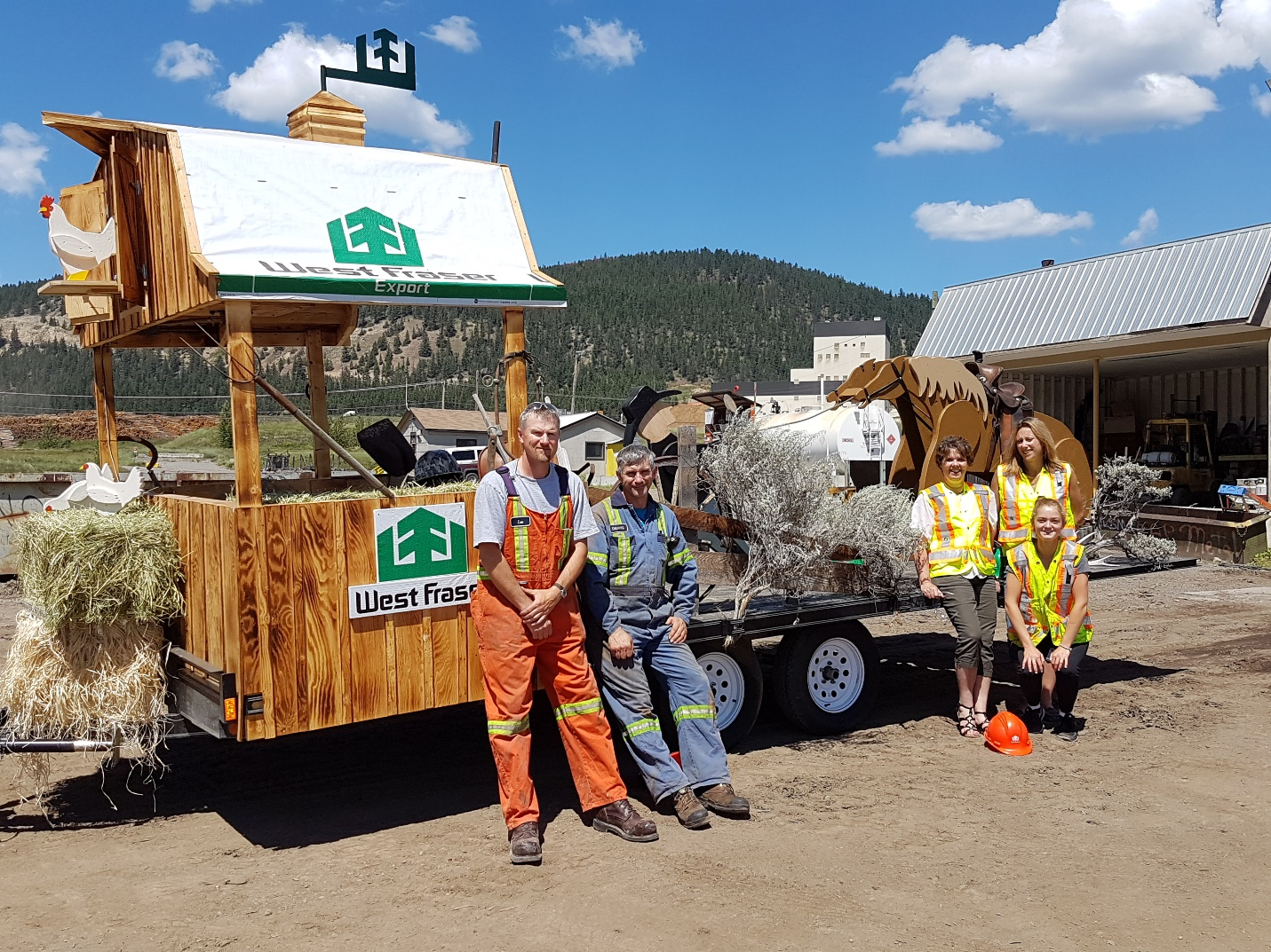 Credit: Gerda Knuff. Here is most of the crew that worked on the float. Our float included a beautiful barn built by the carpenter at the Sawmill, several props (horse, cowboy, chickens, fence, etc.) built by the plywood plant carpenter, and a live band (mainly West Fraser employees)