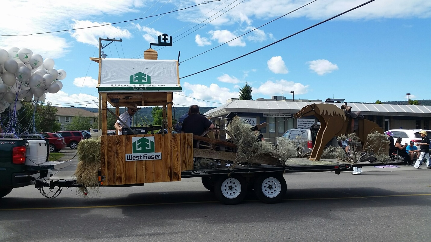 Credit: Gerda Knuff. Here is the float rolling down the street in the parade! Notice the craftsmanship of the horse, cowboy, and barn!