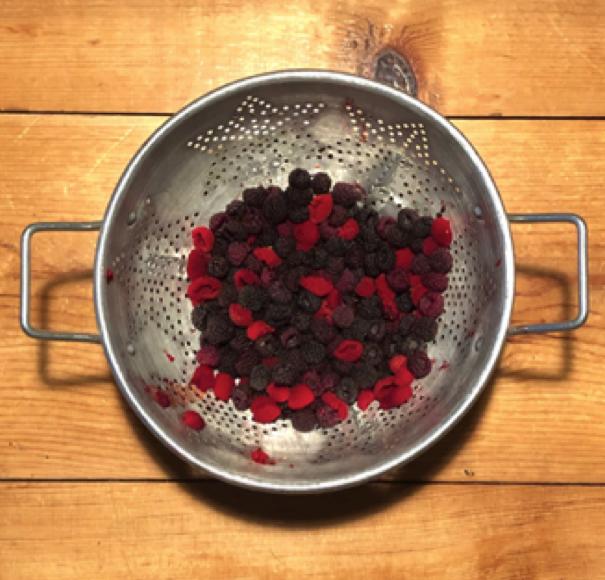 berries in strainer