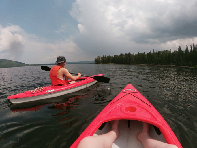two people kayaking in the lake