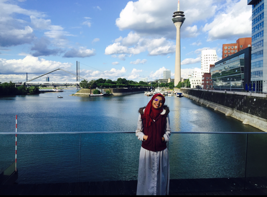 Lina overlooking water in Germany.