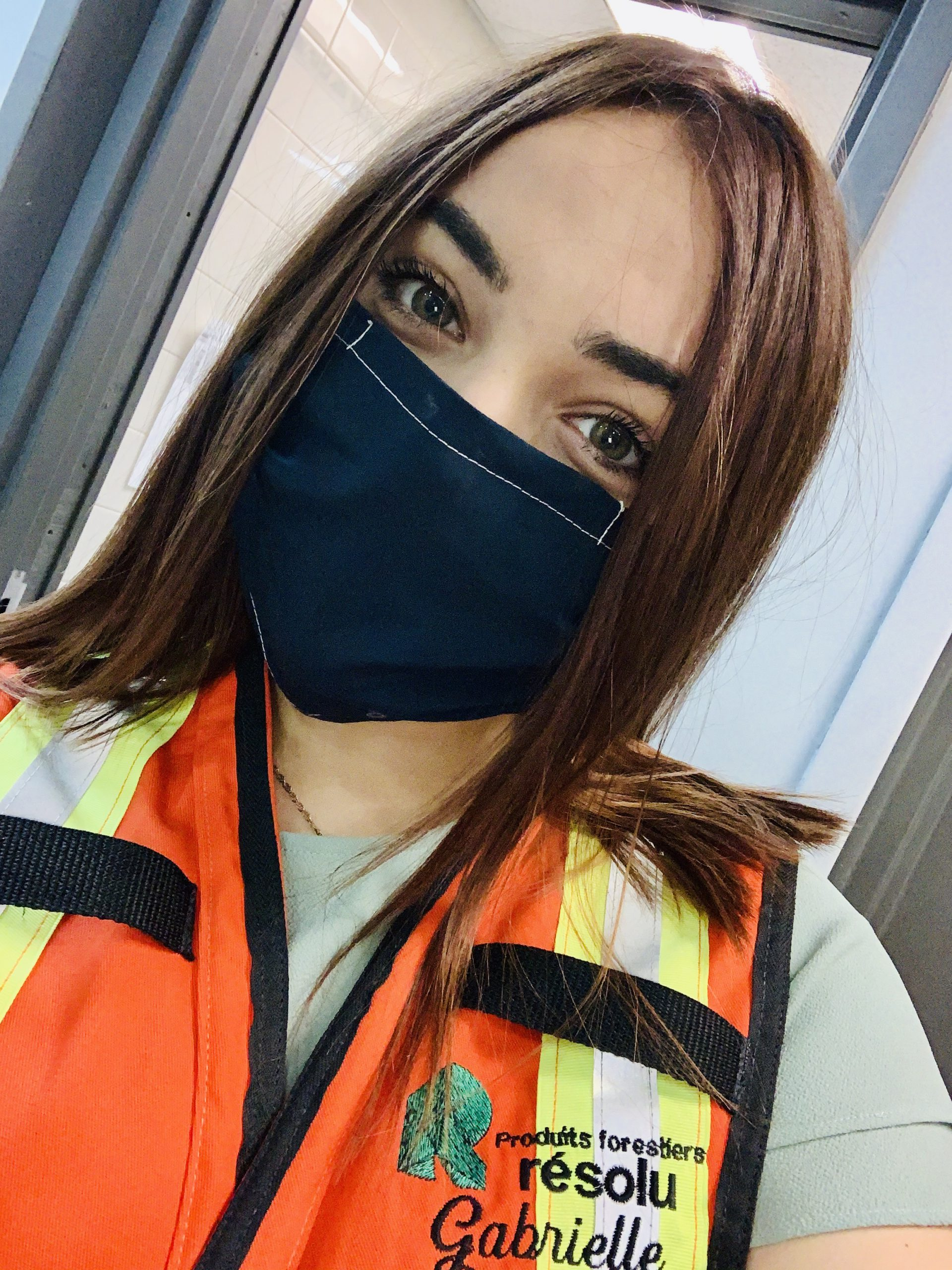 Gabrielle wearing her PPE during a shift.