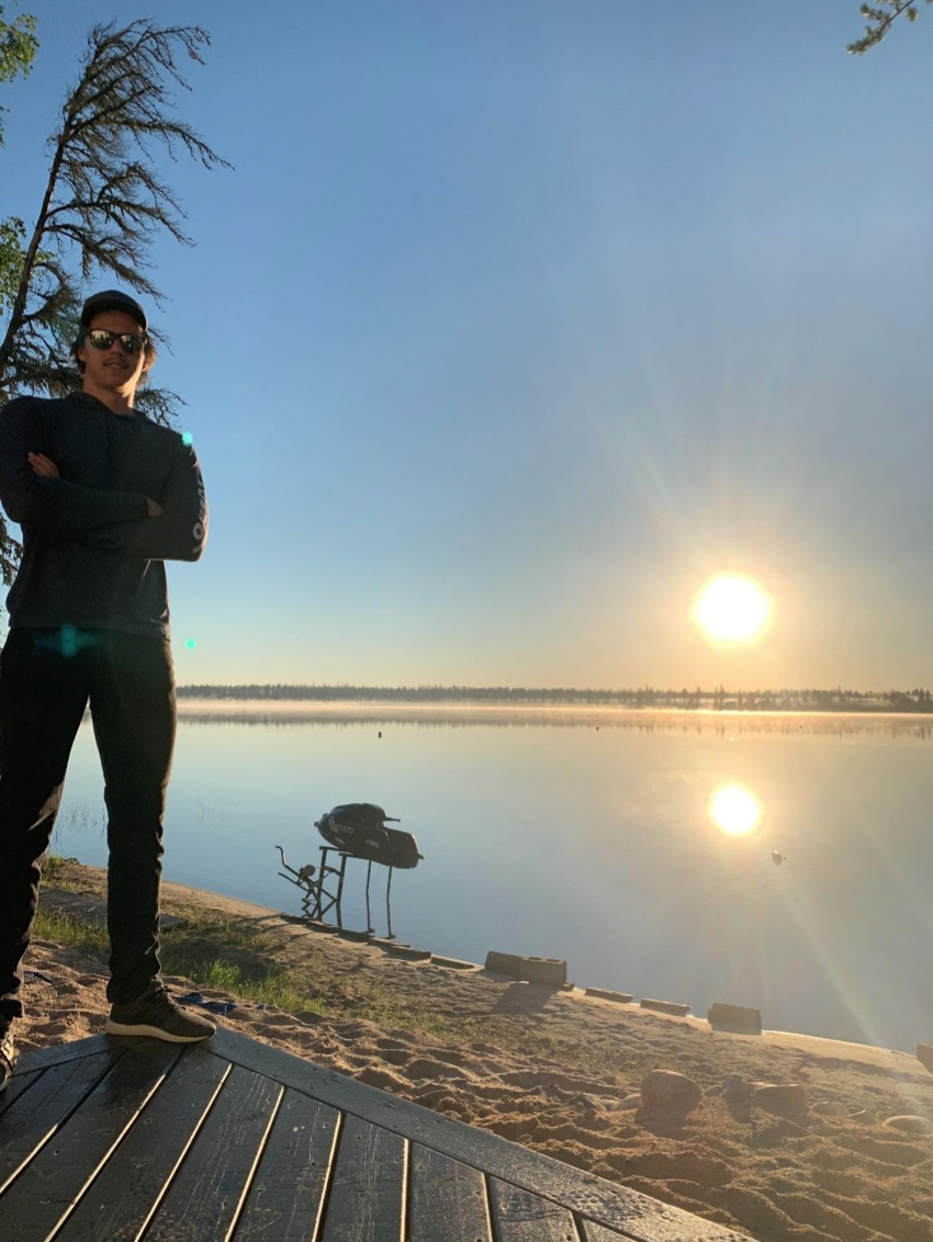 A photo of Jace, standing on his dock.