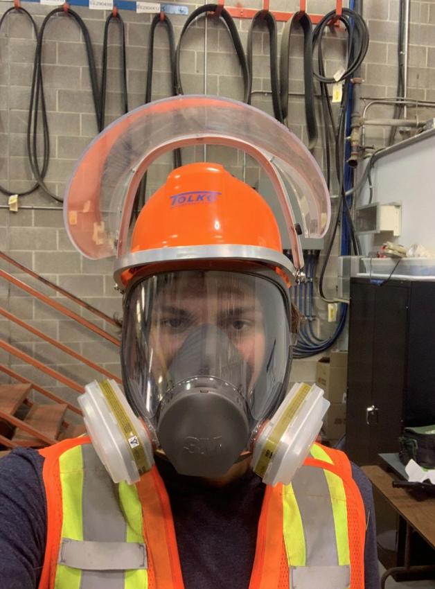 Jace wearing a PPE for hazardous materials.