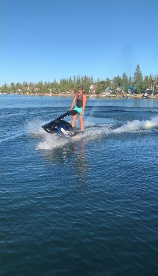 Jace riding a Jet Ski on the Lake.