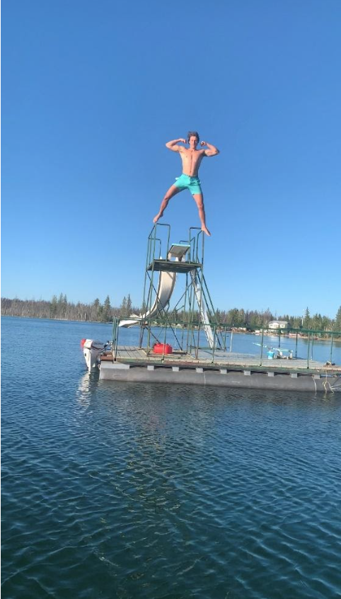 Jace jumping into a lake.