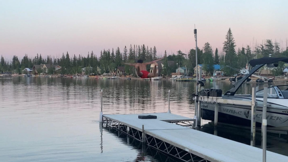 Jace jumping off of his dock into the lake.