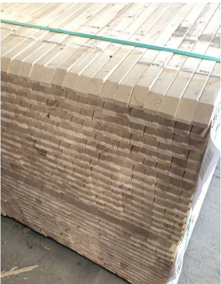 Lumber stacked and read for shipment.
