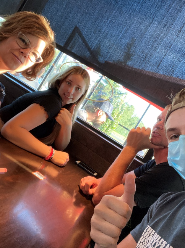 Ty and his family at a restaurant.