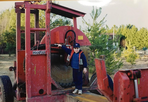 A young Jamie, standing on the back of a slasher.